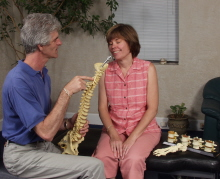 Dr. Cooper shows Andi a representation of the human spine